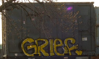 A building features the word grief in graffiti as a symbol for how to stay true to recovery during grief