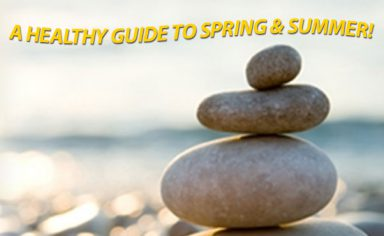 A pile of rocks on the beach with text that reads a healthy guide to spring and summer for having a healthy spring and summer