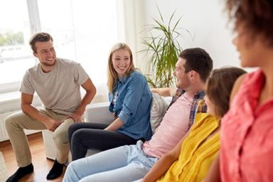 group participating in addiction therapy through addiction therapy services