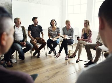 group of individuals participating in a group session at a dual diagnosis treatment center