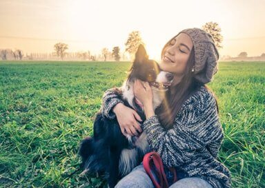 a young woman enjoying a pet friendly rehab