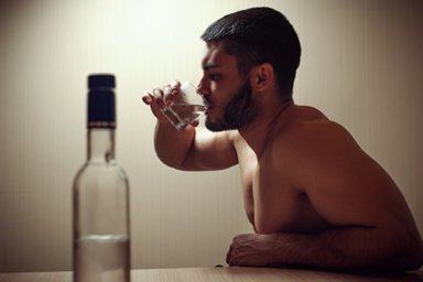 man engaging in addictive behaviors