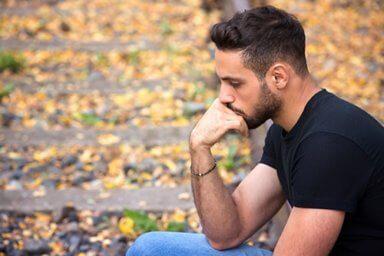 man pondering how to handle opioid withdrawal