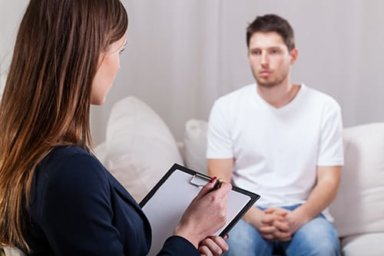 young man considering inpatient drug rehab center in ca